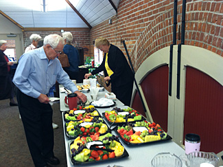 Participants enjoy continental breakfast