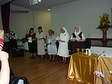 Srs. Tiziana and Maria Helena receive the vow renewals of Srs. Maria Goretti, Maria Bernadete and Julia